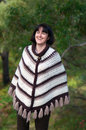 Laughing woman outdoors portrait of mature caucasian heartily and wearing autumn colours crochet poncho Stock Image