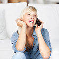 Laughing woman on phone calling using her cellular Royalty Free Stock Photos