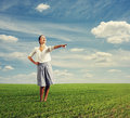 Laughing woman pointing at something photo of in the green field Stock Images