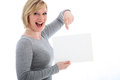 Laughing woman pointing to blank sign Stock Photo