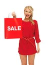 Laughing woman in red dress with shopping bag picture of Stock Image