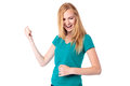 Laughing woman singing and dancing attractive young having fun by herself with her hand raised in the air isolated on white Royalty Free Stock Photography