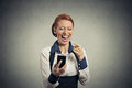 Laughing woman with smart phone Royalty Free Stock Photo