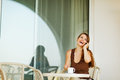 Laughing woman speaking mobile phone at terrace Royalty Free Stock Photo