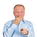 Laughing at you closeup portrait senior mature business man pointing with finger someone something isolated white background Stock Photography
