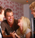 Laughing young friends enjoying at a nightclub Royalty Free Stock Photography