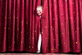 Laughing young girl making her entry on stage Royalty Free Stock Photo