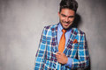 Laughing young man in checkered suit and orange tie Royalty Free Stock Photo