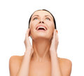 Laughing young woman looking up beauty spa and health concept Royalty Free Stock Photo