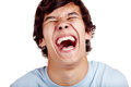 Laughter closeup laughing out loud young man face concept Royalty Free Stock Photo