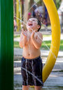 Little boy laughing in a summer fountain Royalty Free Stock Photo