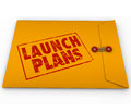 Launch plans yellow envelope start new business company secrets words stamped in red ink on offering advice information steps and Stock Photography