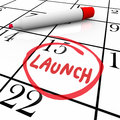 Launch word circled calendar debut new product on date with red marker to illustrate the unveiling or premiere of a or service Stock Images