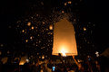 Launching floating lanterns thai people sky lantern for yi peng buddhist festival on november chiangmai thailand Stock Photography
