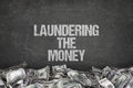 Laundering the money text on black background Royalty Free Stock Photo