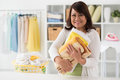 Laundry attendant female with stack of towels in her hands Royalty Free Stock Image