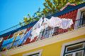 Laundry on the balcony of a typical house in Lisbon, Portugal Royalty Free Stock Photo