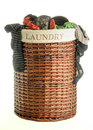 Laundry basket with clothes full female isolated on white background Stock Photography
