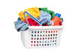 Laundry basket full dirty clothing clothes hangers laundry detergent isolated white designer convenience Stock Image