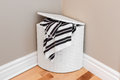 Laundry basket in the room corner white with striped towels Royalty Free Stock Photography