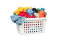 Laundry basket white full of colorful clothing and a bottle of cleaning detergent Royalty Free Stock Photos