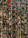 Laundry drying at windows of Chinese residential building