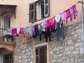 Laundry over washing line fresh washed clothes hanging a mainly pink clothes Royalty Free Stock Photos
