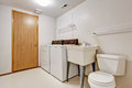 Laundry room interior in old house white simple with toilet Stock Image