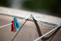 Laundry rope stretched with some colorful clothespin Royalty Free Stock Images