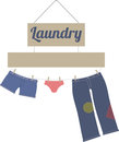 Laundry it s a fun day with this colorful clothes line design jeans shorts and undies line dry under a pretty little sign Stock Photo