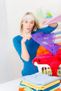Laundry - woman folding clothes home Royalty Free Stock Image
