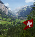 Lauterbrunnen valley and swiss flag Royalty Free Stock Photo