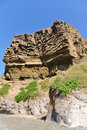 Lava cliff in caldera beach santorini island greece Stock Image