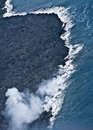 Lava Flowing Into Ocean Royalty Free Stock Photo