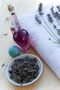 Lavander branch on  the towel with lavender oil bo Royalty Free Stock Photos