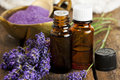 Lavender aromatherapy bottles of essence and bath salt with flowers closeup Stock Images