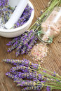 Lavender bath salt on wooden surface Royalty Free Stock Photos