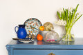Lavender colored cabinet with antique old crockery and glass bowl Stock Images