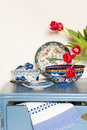Lavender colored cabinet with antique old crockery and glass bowl cookies Royalty Free Stock Photography