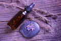 Lavender essential oil with lavendula flowers on the rock dry leaves of this herb near the bottle Stock Photography