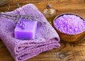 Lavender flowers extract spa soap, oil bottle and bath salt bowl Royalty Free Stock Photo