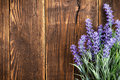 Lavender flowers on a wooden background Stock Photo