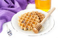 Lavender honey and belgian waffles delicious dessert with on a white background Royalty Free Stock Photos