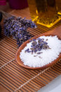 Lavender massage oil and bath salt aroma therapy wellness beauty spa objects Stock Photos
