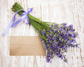 Lavender on vintage wood with old blank tag Stock Photo