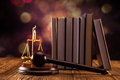 Law concept mallet legal code and scales of justice studio shots Stock Images