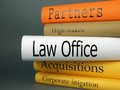 Law office law practice books a horizontal stack of related book titles Stock Photo