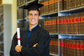 Law school graduate handsome university in library Stock Photos