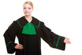 Law woman lawyer in polish gown inviting welcome court or justice attorney wearing classic poland black green making hand sign Royalty Free Stock Images