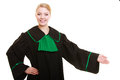 Law woman lawyer in polish gown inviting welcome court or justice attorney wearing classic poland black green making hand sign Stock Photography
